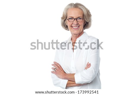 Confident beautiful aged woman against white
