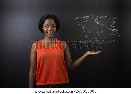 Confident beautiful South African or African American woman teacher or student with chalk geography world map on blackboard background - stock photo