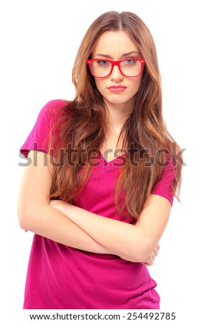 Confident beauty. Unhappy young women keeping arms crossed and smirking while standing against grey background - stock photo