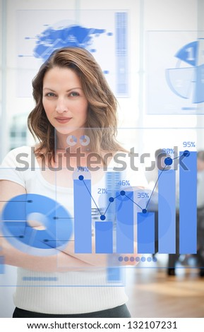 Confident blonde businesswoman using chart interfaces with statistics