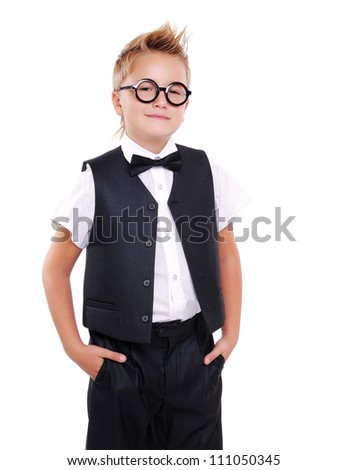 Confident boy in bow tie and suit holding hands in pockets - stock photo