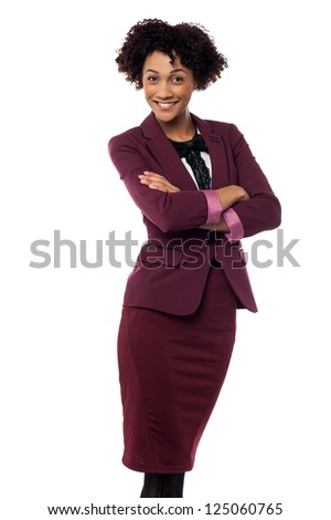 Confident business executive on white background posing with arms crossed.