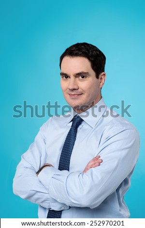 Confident business executive with folded arms. - stock photo