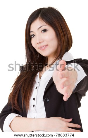 Confident business executive woman of Asian make a handshake with you, half length closeup portrait on white background.