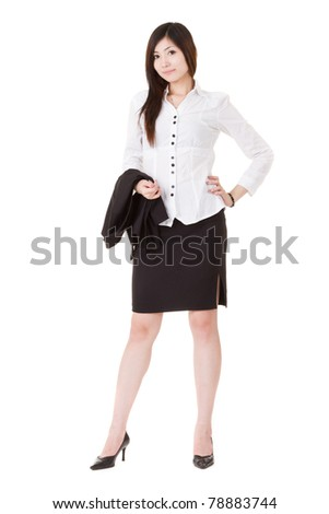Confident business executive woman of Asian standing and holding her coat, full length portrait isolated on white background. - stock photo