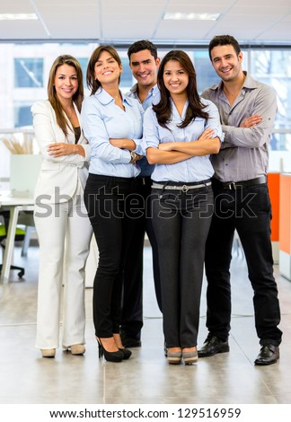 Confident business group looking happy at the office - stock photo