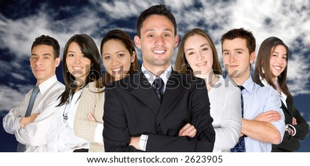 confident business man and his business team - group formed of people from all over the world over a sky - stock photo