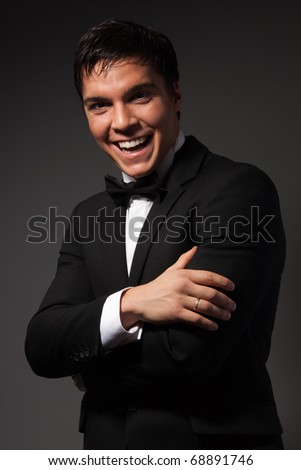 Confident business man laughing with positive expression looking at camera