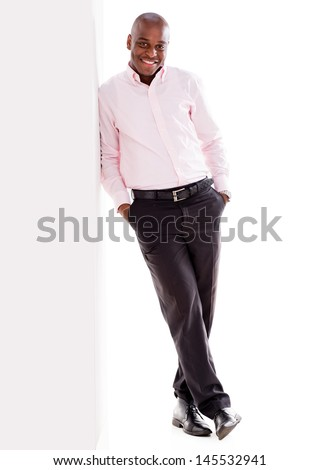 Confident business man leaning against a wall - isolated over white  - stock photo