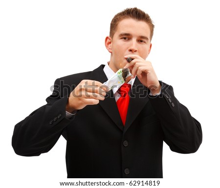 Confident business man lighting a cigar with one hundred euro banknote - stock photo