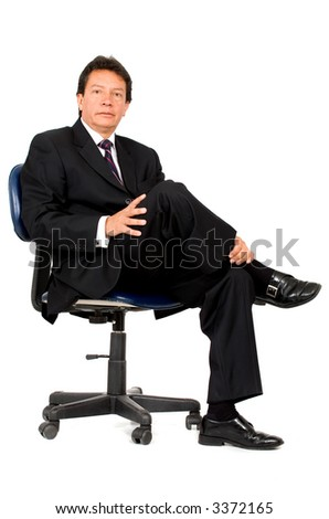 confident business man portrait sitting on a chair - isolated over a white background - stock photo