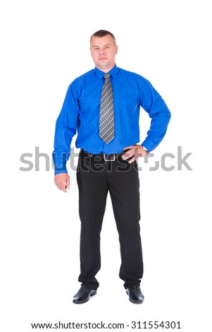 Confident business man. Successful businessman in blue shirt and tie holding hand on hip while standing against isolated white background. Concept of leadership and success - stock photo