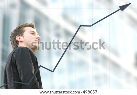 confident business man with a graph goind upwards - stock photo