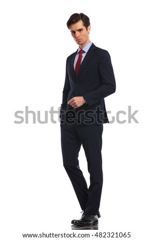 confident business man with hand in pocket looks at the camera on white backogrund