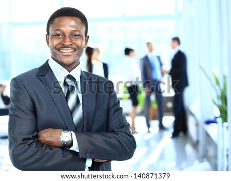 Confident business man with his team behind - stock photo