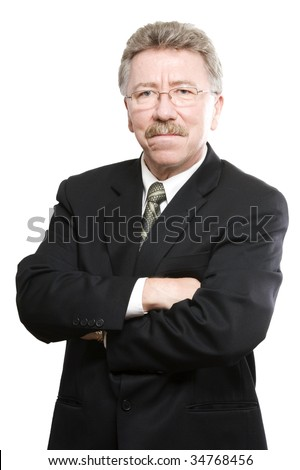 Confident business man with serious face and crossed arms - stock photo