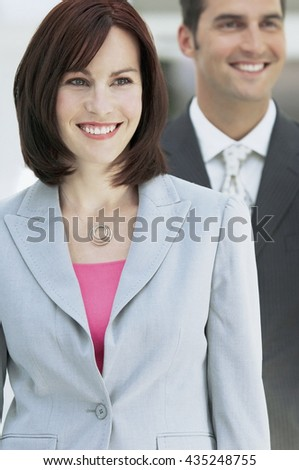 Confident business partners in business ambience - stock photo