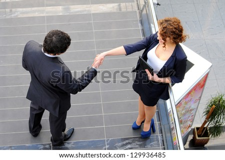 Confident business partners in office building. view from above - stock photo
