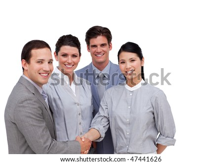 Confident business partners shaking hands against a white background