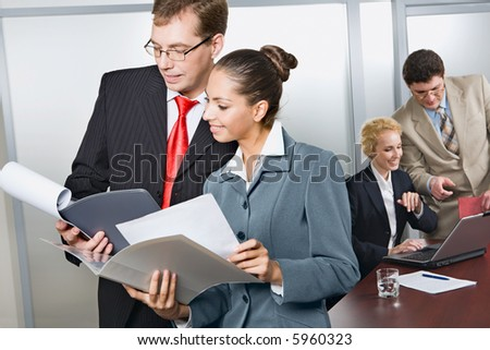 Confident business people are discussing business strategy in the office
