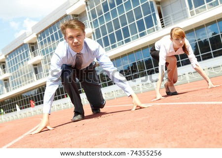 Confident business people getting ready for race - stock photo