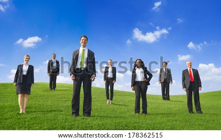 Confident Business People on a Hill - stock photo