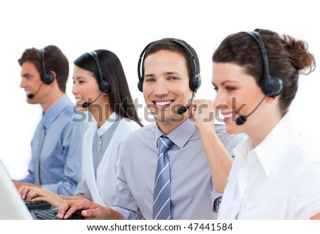 Confident business people talking on headset in a call center