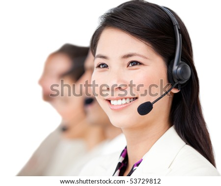 Confident business people with headset on standing against a white background