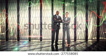 Confident business team against stocks and shares on black background - stock photo
