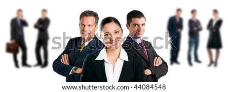 Confident business team with colleagues standing in the background isolated on white