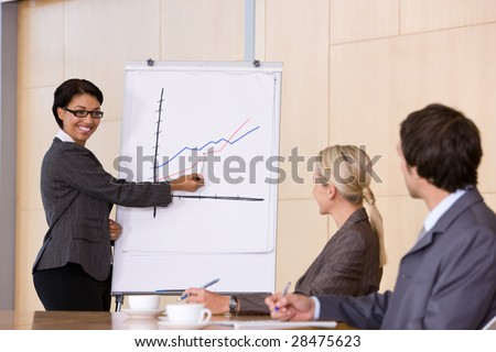 confident business woman giving presentation - stock photo