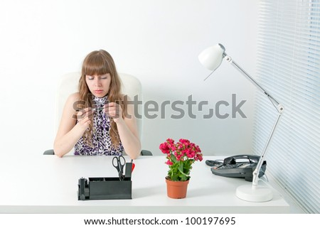 Confident business woman in a comfortable modern office - stock photo
