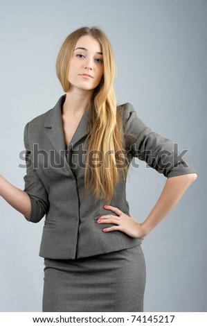Confident business woman in gray suit - stock photo
