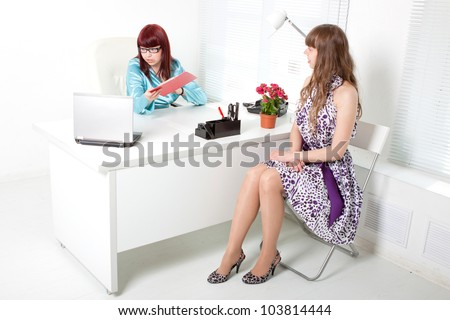 Confident business woman interviewing a young girl