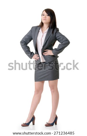 Confident business woman of Asian, full length portrait on white background. - stock photo