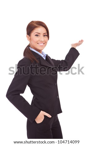 Confident business woman presenting something in back,  isolated over a white background