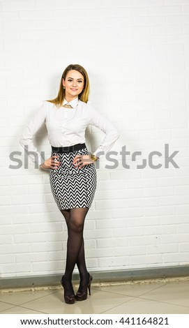 Confident business woman standing full length. Businesswoman or real estate agent indoors. - stock photo