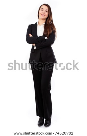 Confident business woman standing full length in black suit, isolated on white background