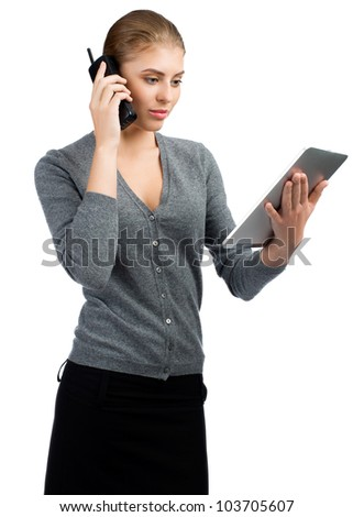 Confident business woman talking on telephone and using tablet computer. Isolated on white background