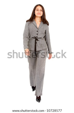 confident business woman walking wearing elegant clothes - isolated over a white background - stock photo