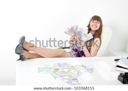 Confident business woman with a lot of money - stock photo
