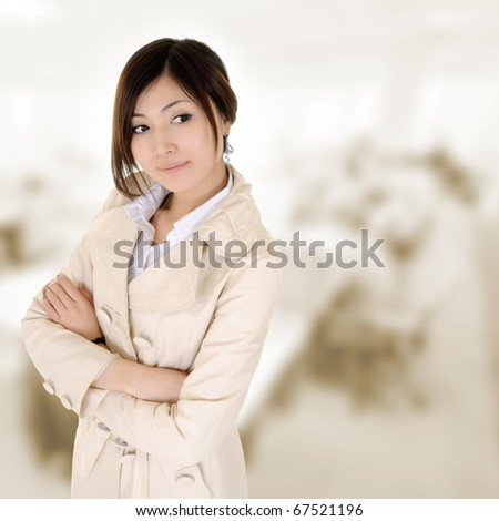 Confident business woman with coat thinking in office. - stock photo