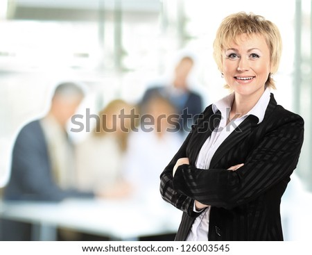 confident business woman with team behind her - stock photo