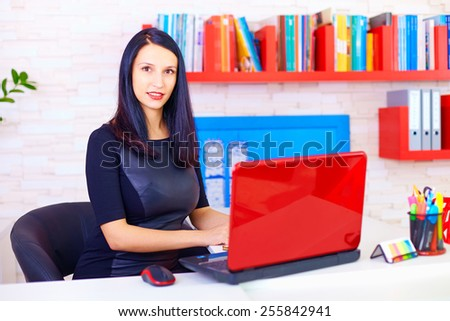 confident business woman working in office - stock photo