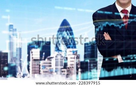 Confident businessman and bank office building in background - stock photo