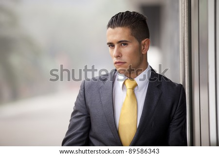 Confident businessman at the office exterior