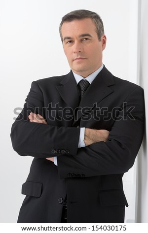 Confident businessman. Confident middle-age man in formalwear looking at camera - stock photo