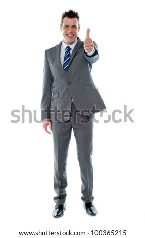 Confident businessman gesturing thumbs up isolated over white - stock photo