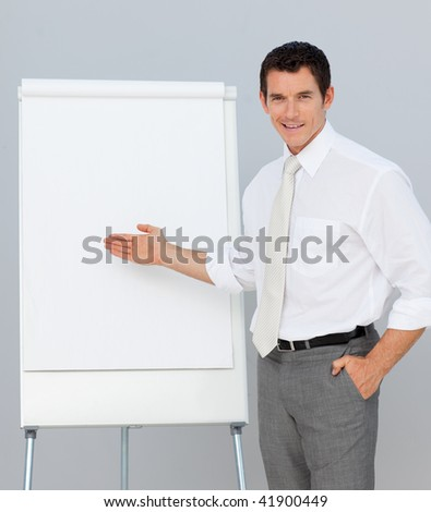 Confident businessman giving a presentation in the office