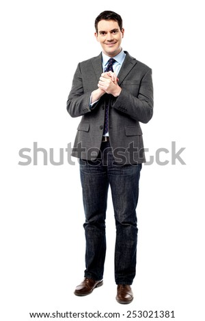 Confident businessman holding his hands clasped - stock photo